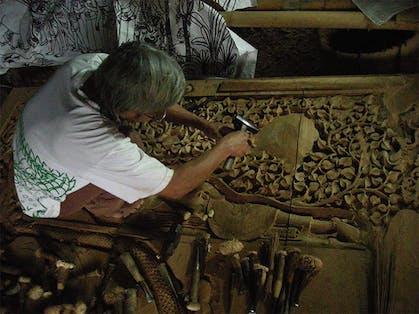 A traditioanl Thai woodcarver at work in Bann Tawai, Chiang Mai