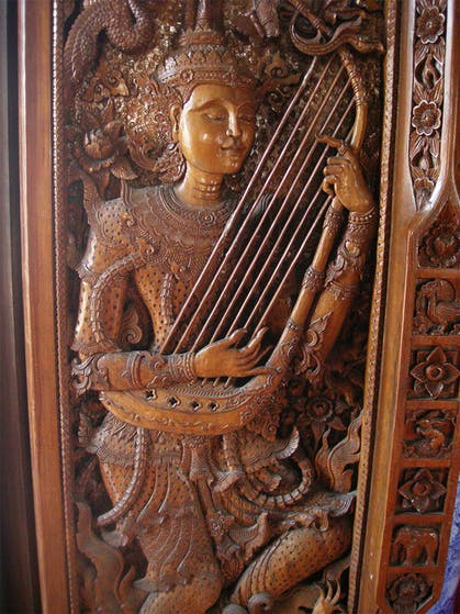 Traditional Thai wood carving of a musician
