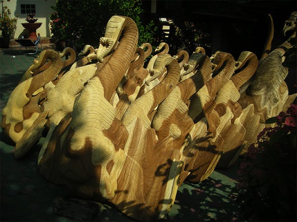 Intricate Thai woodcarving of elephants