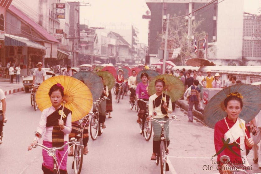 Borsang Umbrella ladies riding bikes through Chiang Mai 1970s