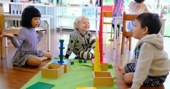 Happy toddlers working together at Chiang Mai Montessori International Scho